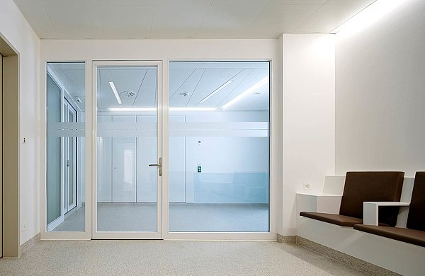 fire-rated door EI30 with screen abutments. Used profile system: forster fuego light Hospital Münsterlingen, Switzerland