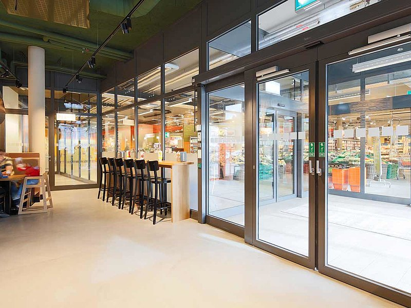 fire-rated sliding door with escape-route function and glazing EI30, forster fuego light Residential and commercial building Krone, Switzerland