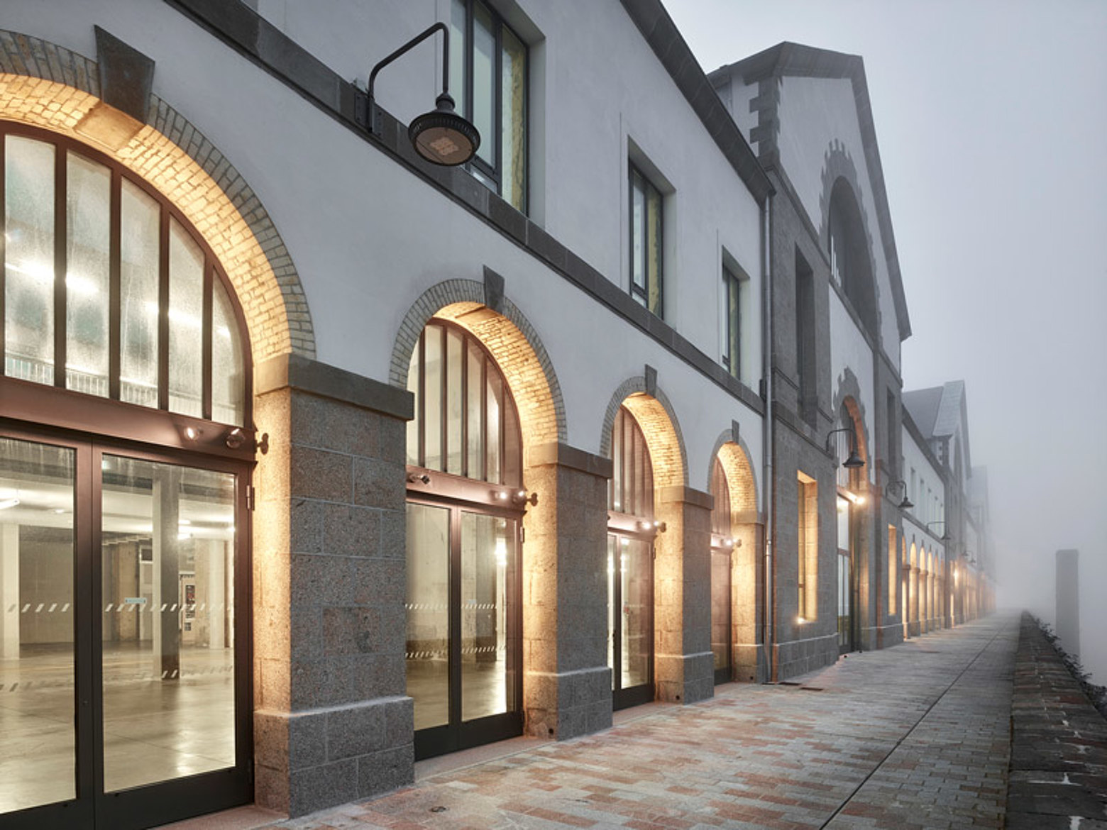 """Large doors and glazing with thermal insulation made of forster unico steel profiles. Renovation of the old buildings """"les Ateliers des Capucins"""" in France."""