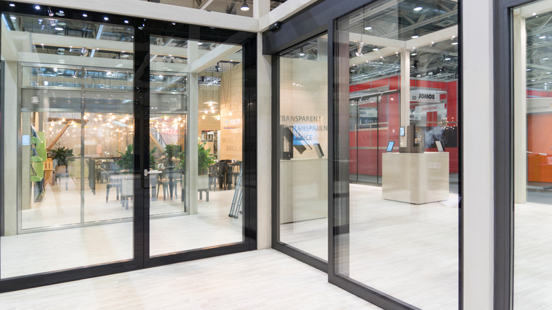 in all-glass design and a sliding door